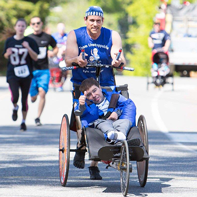Michael DiDonato pushing Kyle During a Race